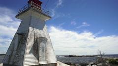 Old Lighthouse Overlooking the Atlantic Ocean in Nova Scotia Stock Footage
