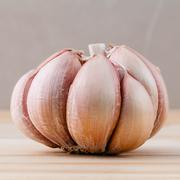 Close Up organic garlic with selective focus on the teak wood background Stock Photos