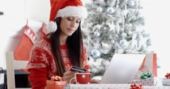 Young woman ordering Christmas gifts online Stock Footage