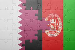 puzzle with the national flag of afghanistan and qatar - stock photo
