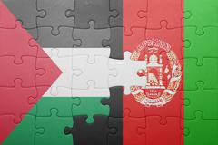 puzzle with the national flag of afghanistan and palestine - stock photo