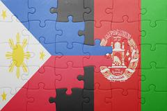 puzzle with the national flag of afghanistan and philippines - stock photo