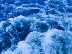Stock Photo of powerful stream of blue water