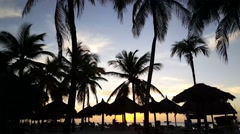 Stock Video Footage of Time lapse from the sunset at Palm Beach on Aruba