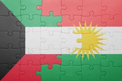 puzzle with the national flag of kurdistan and kuwait - stock photo