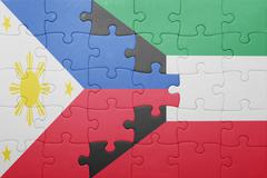 puzzle with the national flag of kuwait and philippines - stock photo