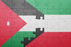 puzzle with the national flag of kuwait and jordan - stock photo