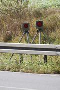 Radar trap hidden behind a safety fence - stock photo