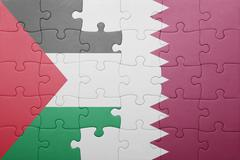 puzzle with the national flag of qatar and palestine - stock photo