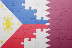 puzzle with the national flag of qatar and philippines - stock photo