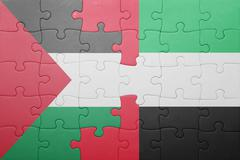 puzzle with the national flag of united arab emirates and palestine - stock photo