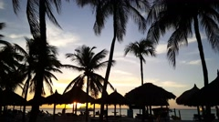 Stock Video Footage of Sunset with sailboat at palm beach in Aruba