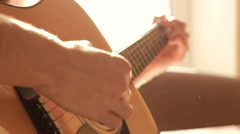 Playing acoustic guitar - stock footage