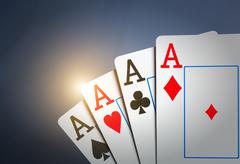 Four aces on grey - stock illustration