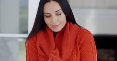 Woman cuddling down in her warm winter fashion - stock footage