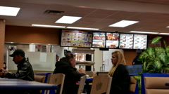 People eating foods inside Burger king restaurant Arkistovideo