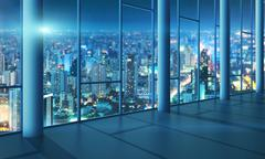 Office with glass wall and evening city - stock illustration