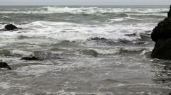 Waves From Low Angle Coming Into Rocky Shore Stock Footage