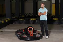 Man Is Driving Go-Kart With Speed In Karting - stock photo