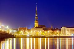 Riga. View  the Church of St. Peter at night - stock photo