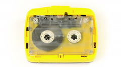 Yellow vintage audio cassette player with a tape playing in - stock footage