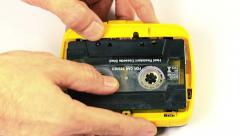 Inserting and playing cassette tape in the walkman Stock Footage