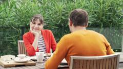 Couple during breakfast on terrace, portrait of happy, pretty woman Stock Footage