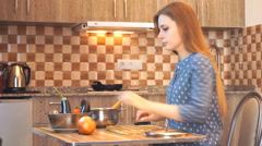 Healthy food lifestyle: beautiful woman casually cooking, washing vegetables Stock Footage