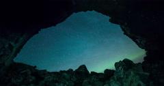 Aurora through a volcanic Cave Stock Footage