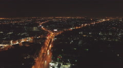 Aerial shot of city at night - stock footage