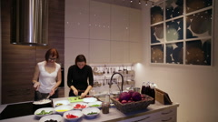 Women cook dinner in the kitchen Stock Footage