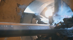 Welding robots movement in a wild for the creation of pipes.a lot of sparks Stock Footage