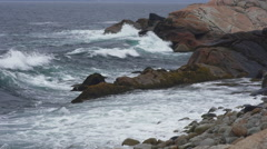 Rough Atlantic Ocean waves crash into the rock in dramatic slow motion Stock Footage