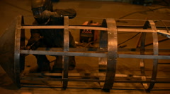 Welding Engineer completes the weld cell skeleton of metal tanks. lot of bright Stock Footage