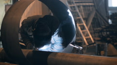 Welding Engineer weld for the creation of pipes.a lot of sparks, smoke and light Stock Footage