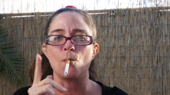 A woman smoking a cigarette Stock Footage
