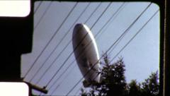 Goodyear Blimp Airship UFO Zeppelin Dirigible Fly Vintage Film Home Movie 8622 - stock footage