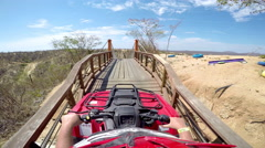 First person POV of a four wheeler about to drive across a hanging bridge Stock Footage