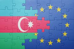 puzzle with the national flag of azerbaijan and european union - stock photo
