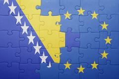 puzzle with the national flag of bosnia and herzegovina and european union - stock photo