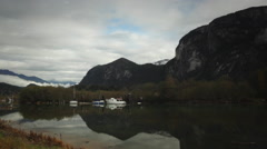 Time-lapse Stuwamus Chief Mountain & boats reflected in water Stock Footage