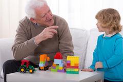 Joking with grandson - stock photo