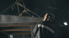 Welding in metal industry. A factory worker welding with protective mask in Stock Footage