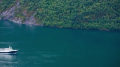 GEIRANGER FJORD, NORWAY - JULY 15, Ferryboat in Norwegian Fjord, Aerial View Stock Footage