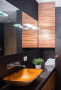 Shiny bathroom in dark colours Stock Photos