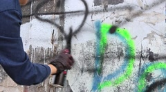 Graffiti artist painting on the wall Stock Footage