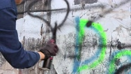 Stock Video Footage of Graffiti artist painting on the wall