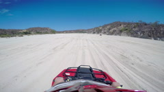 First person POV of a four wheeler driving on trails at the coast - stock footage