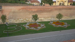 Green space with flowers arranged in the 300 number shape in Alba Iulia Stock Footage