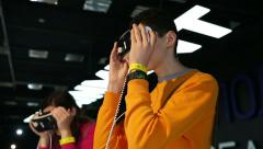 Virtual reality game. Young man uses a head mounted display. Stock Footage